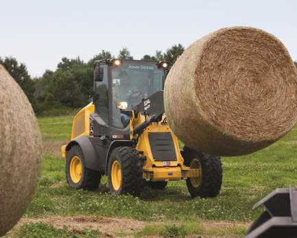 320G Wheel Loader Carrying Bale of Hay