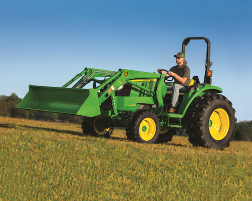 4044M Compact Tractor working out in Field