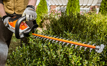 Stihl Hedge Trimmer using precision on hedge