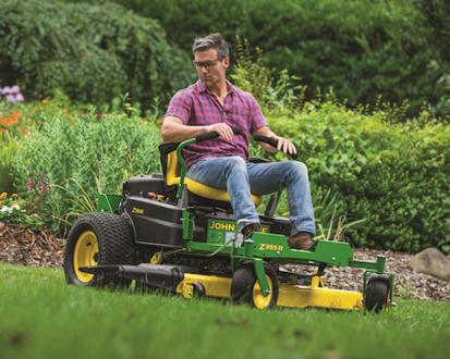 Man using John Deere ZTrak Mower on his lawn
