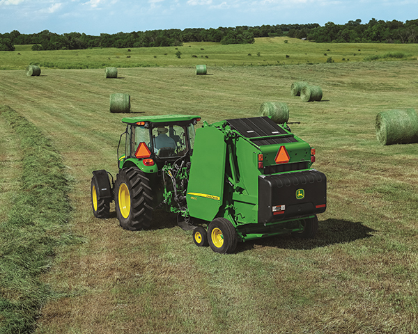 John Deere 450 Round Baler pulled by a Utility Tractor