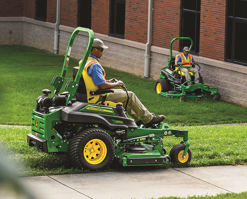 Two commercial ZTrak Zero-Turn Mowers mowing the lawn